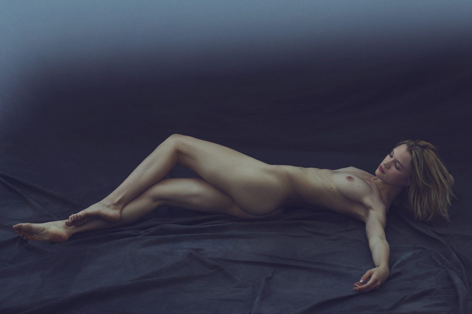 Naked girl lying on floor by Stefan Rappo