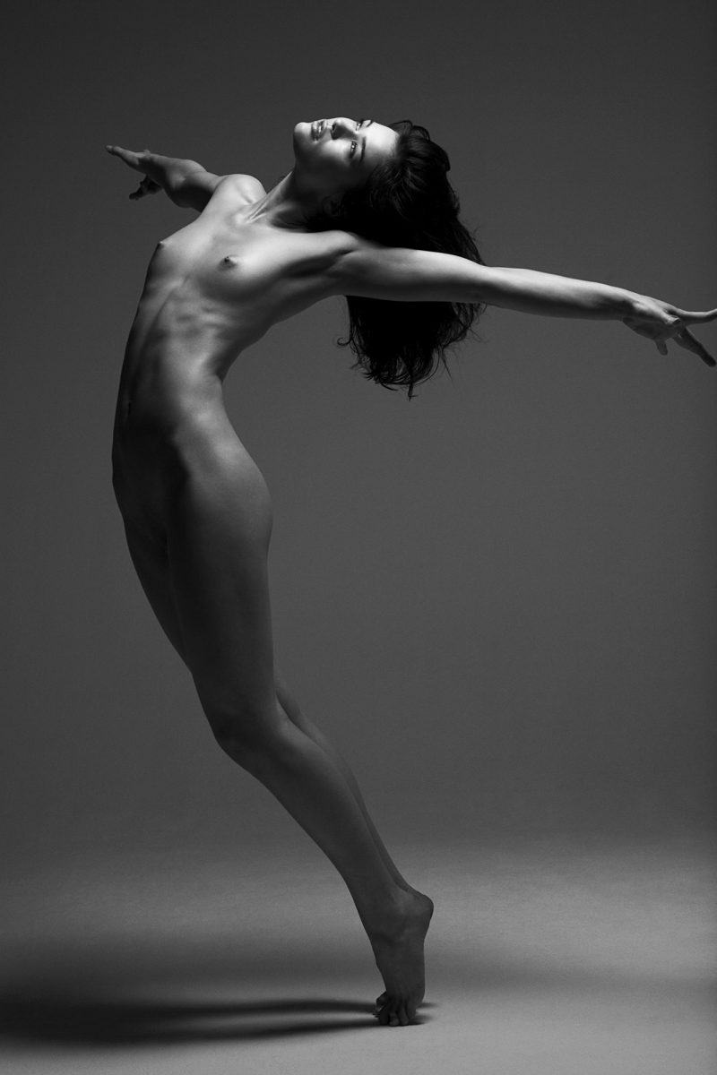 Naked girl in studio by Stefan Rappo