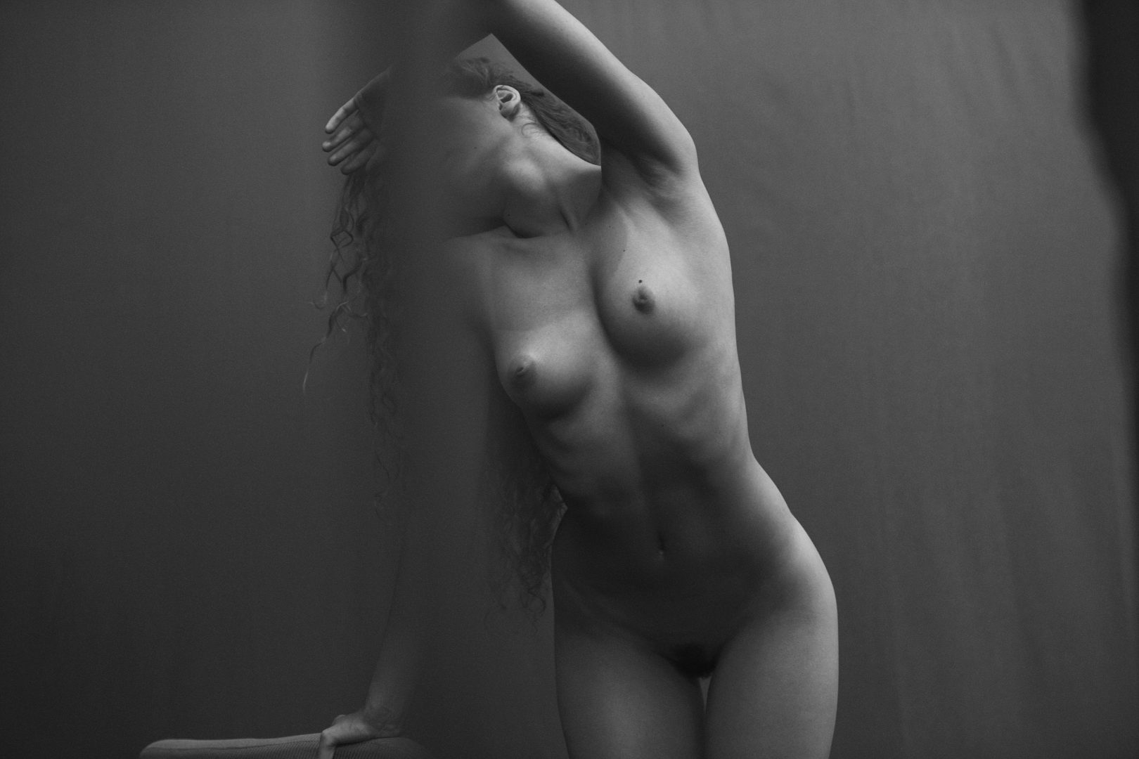 Naked girl in a studio by Stefan Rappo