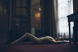Thumbnail Naked girl lying on floor in hotel room by Stefan Rappo
