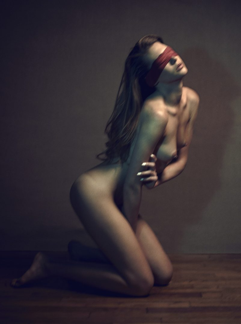 Naked girl on her knees with eyes bended by Stefan Rappo