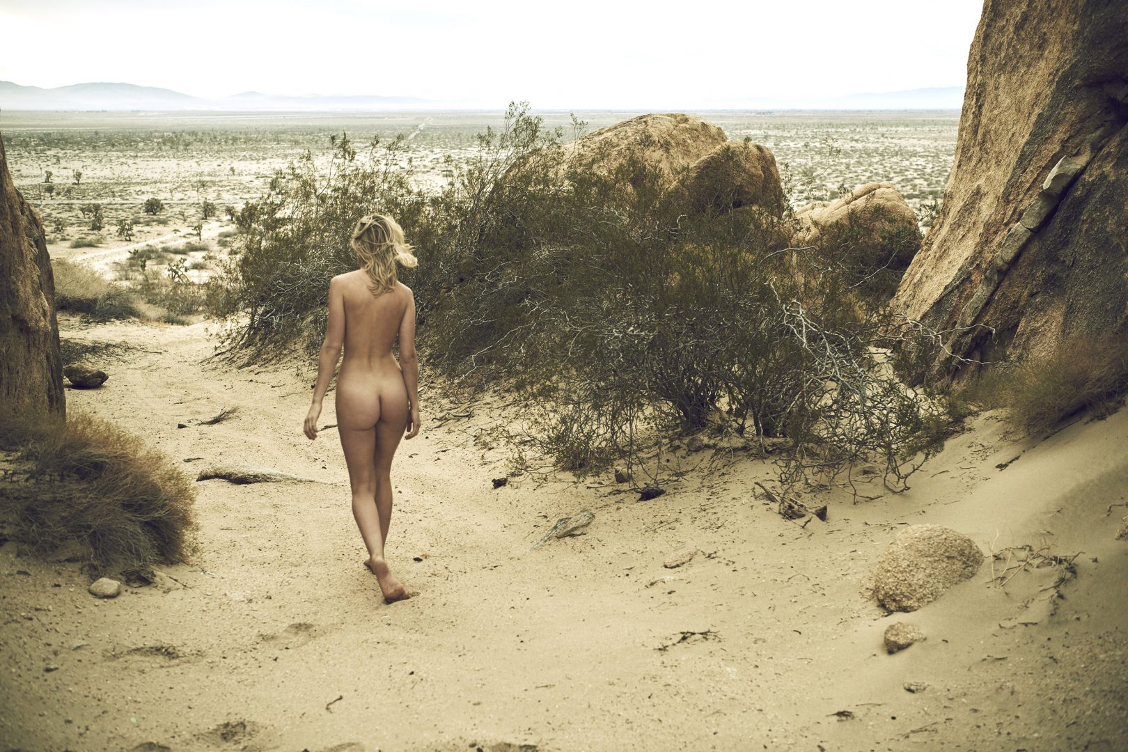 Naked girl walking in the desert by Stefan Rappo