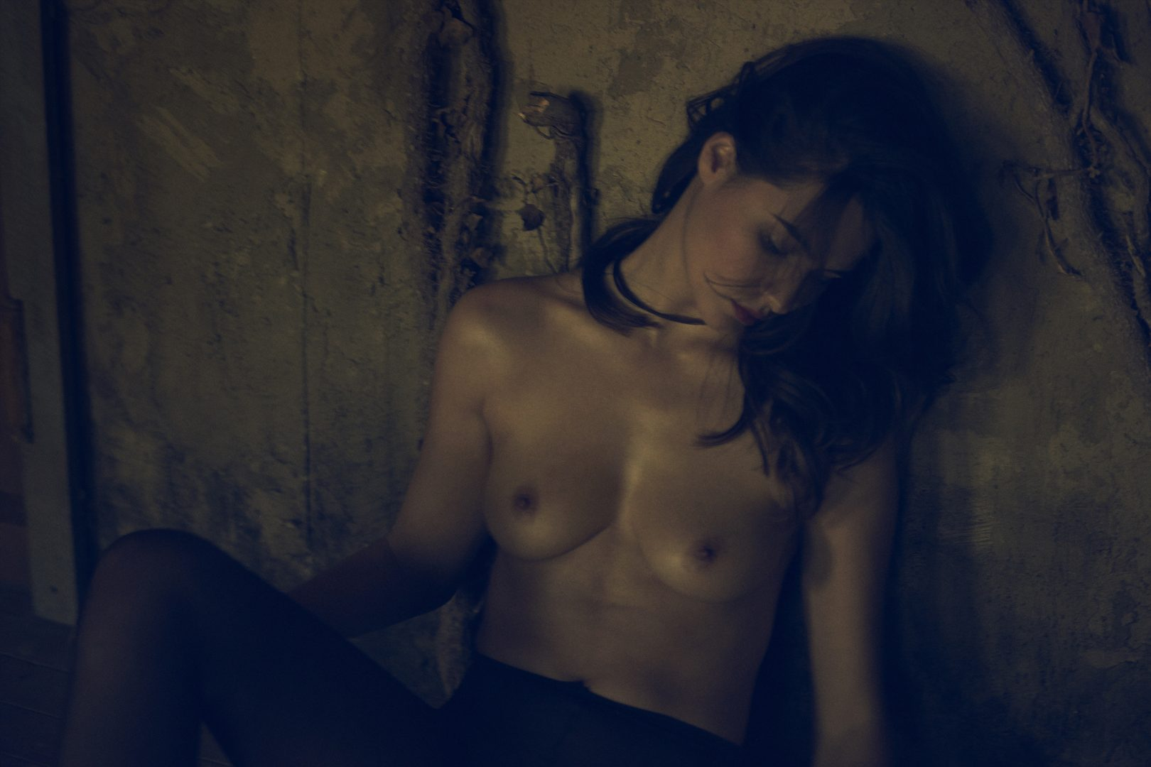 Topless girl sitting in floor by Stefan Rappo
