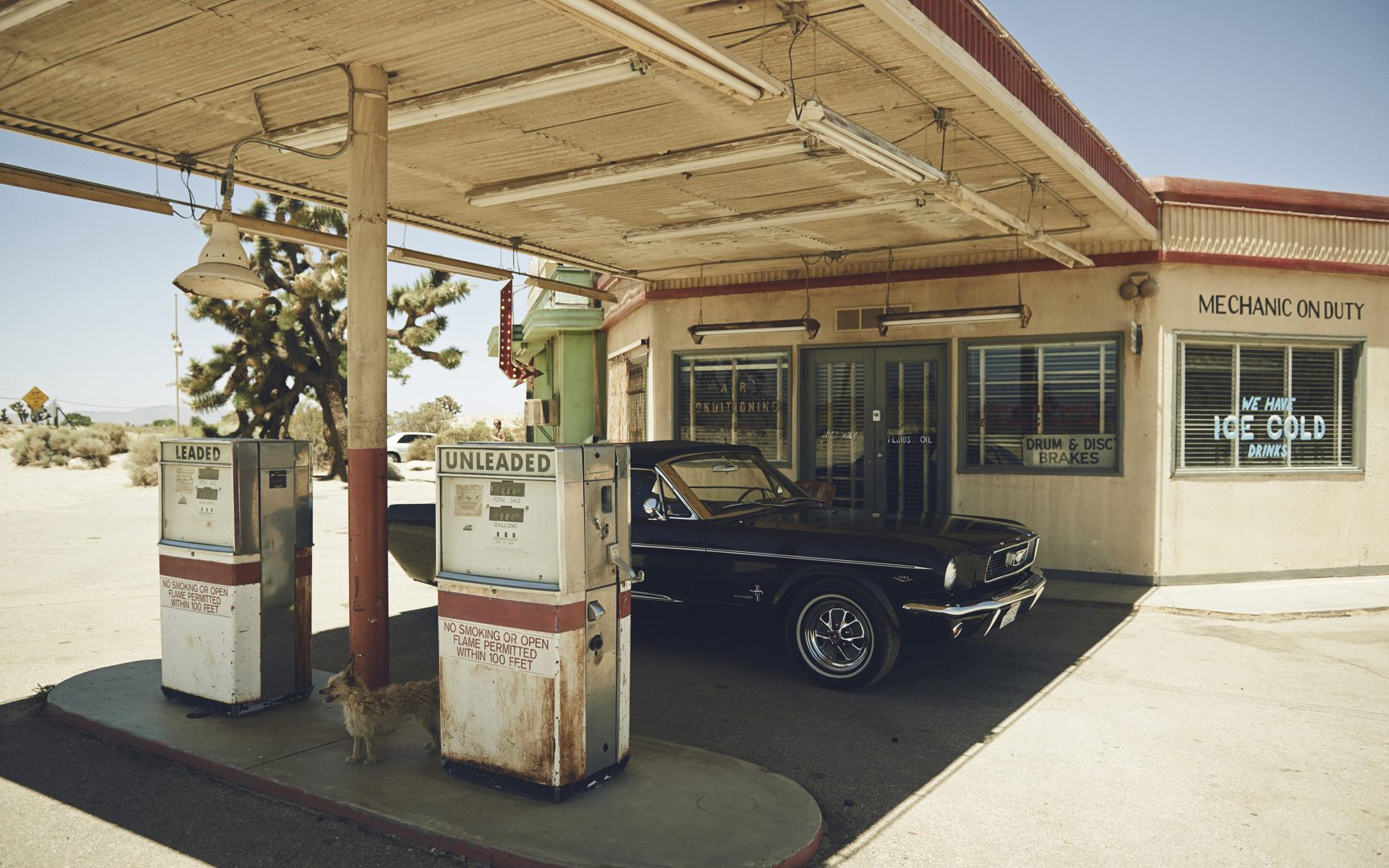 Ford Mustang in front of gas station by Stefan Rappo