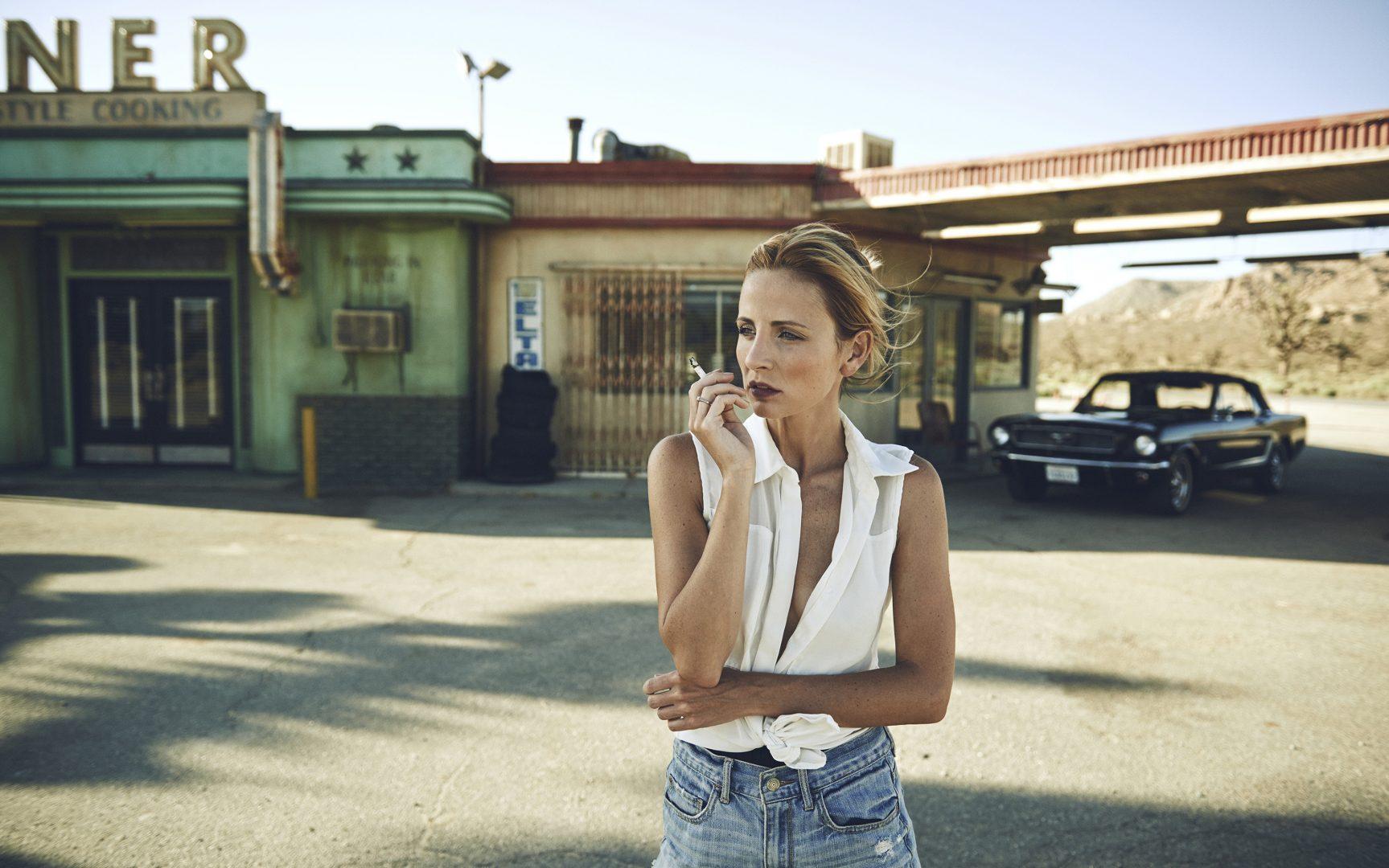 Girl smoking in by Stefan Rappo