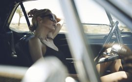 Thumbnail Girl waiting in a Ford Mustang by Stefan Rappo