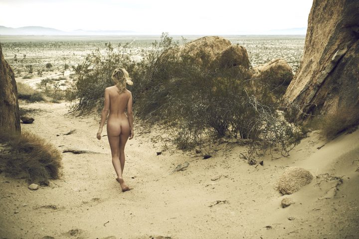 Naked girl walking in desert by Stefan Rappo