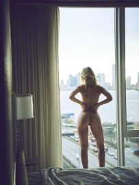 Thumbnail Naked girl standing at the window in hotel room by Stefan Rappo