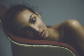 Thumbnail Portrait of girl on chair by Stefan Rappo