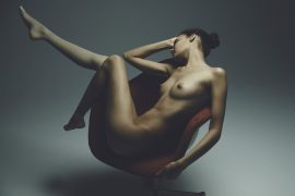 Thumbnail Girl sitting naked on chair by Stefan Rappo