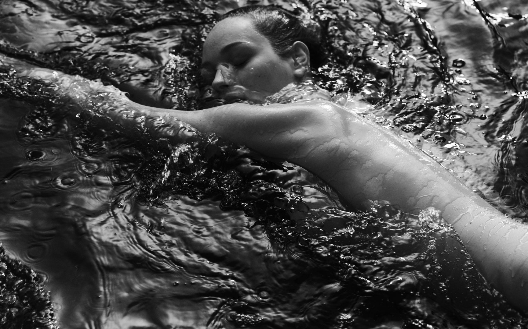 Naked girl merging in water by Stefan Rappo