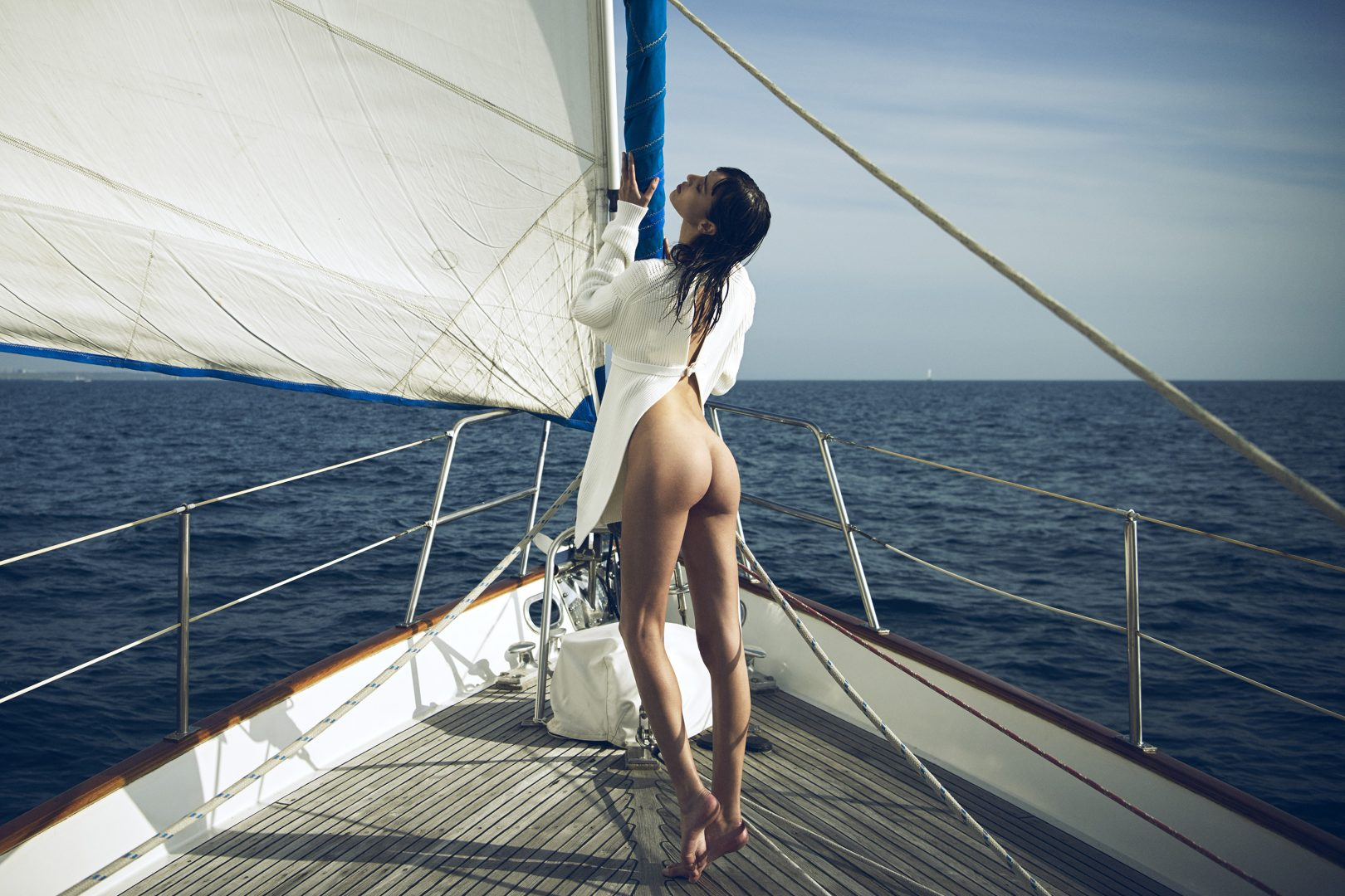 Girl on sailing boat form the back by Stefan Rappo