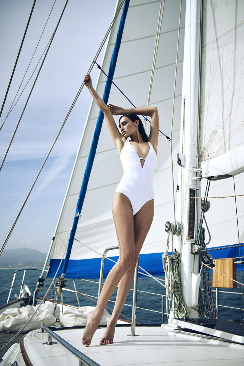 Girl on swimsuit on sailing boat by Stefan Rappo