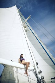Thumbnail Girl sitting on sailing boat by Stefan Rappo