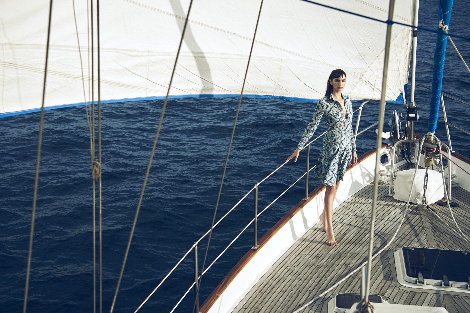 Girl standing on sailing boat by Stefan Rappo