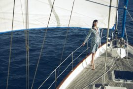 Thumbnail Girl standing on sailing boat by Stefan Rappo