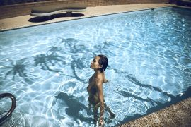Thumbnail Girl standing naked in swimming pool by Stefan Rappo