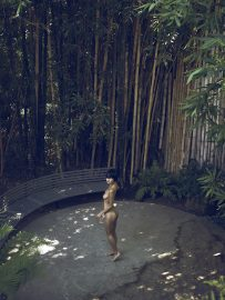 Thumbnail Naked girl in front of bamboo trees by Stefan Rappo