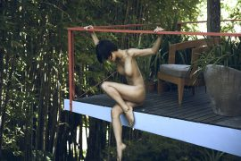 Thumbnail Naked girl on terrace by Stefan Rappo