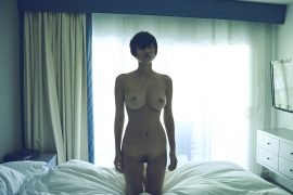 Thumbnail Naked girl on her knees on bed in hotel room by Stefan Rappo