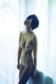 Thumbnail Naked girl with coffee cup in front of window in hotel room by Stefan Rappo