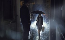 Thumbnail Girl walking to house under rain, man is waiting at her at the door by Stefan Rappo