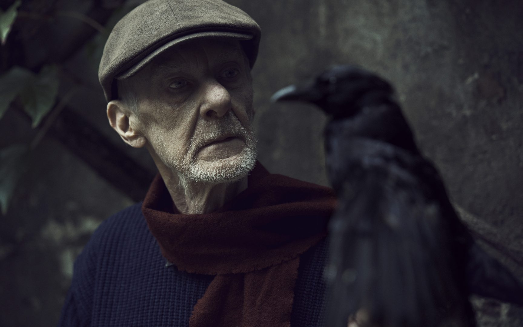 Man with crow by Stefan Rappo