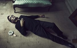 Thumbnail Man lying on floor with a cigarette and a glass of alcohol by Stefan Rappo