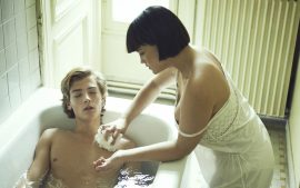 Thumbnail Girl giving boy a bath by Stefan Rappo