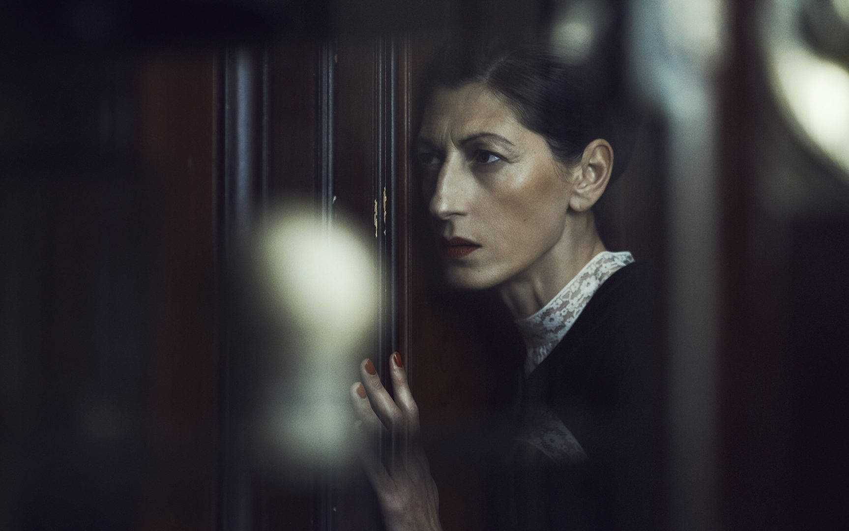 Women listen to conversation at door by Stefan Rappo