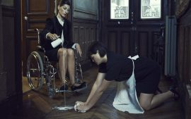 Thumbnail Women in wheel chair pour out milk on the floor, girl cleans it up by Stefan Rappo
