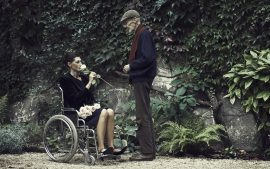 Thumbnail man giving a rose to women in wheelchair by Stefan Rappo