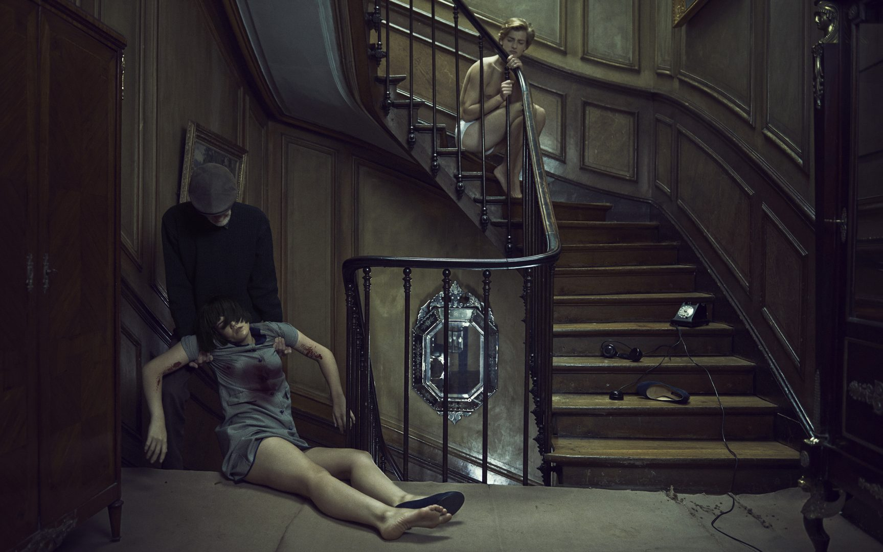 Man pulling dead body of girl away watched by boy by Stefan Rappo