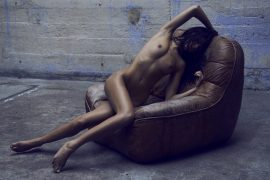 Thumbnail Naked girl sitting by Stefan Rappo