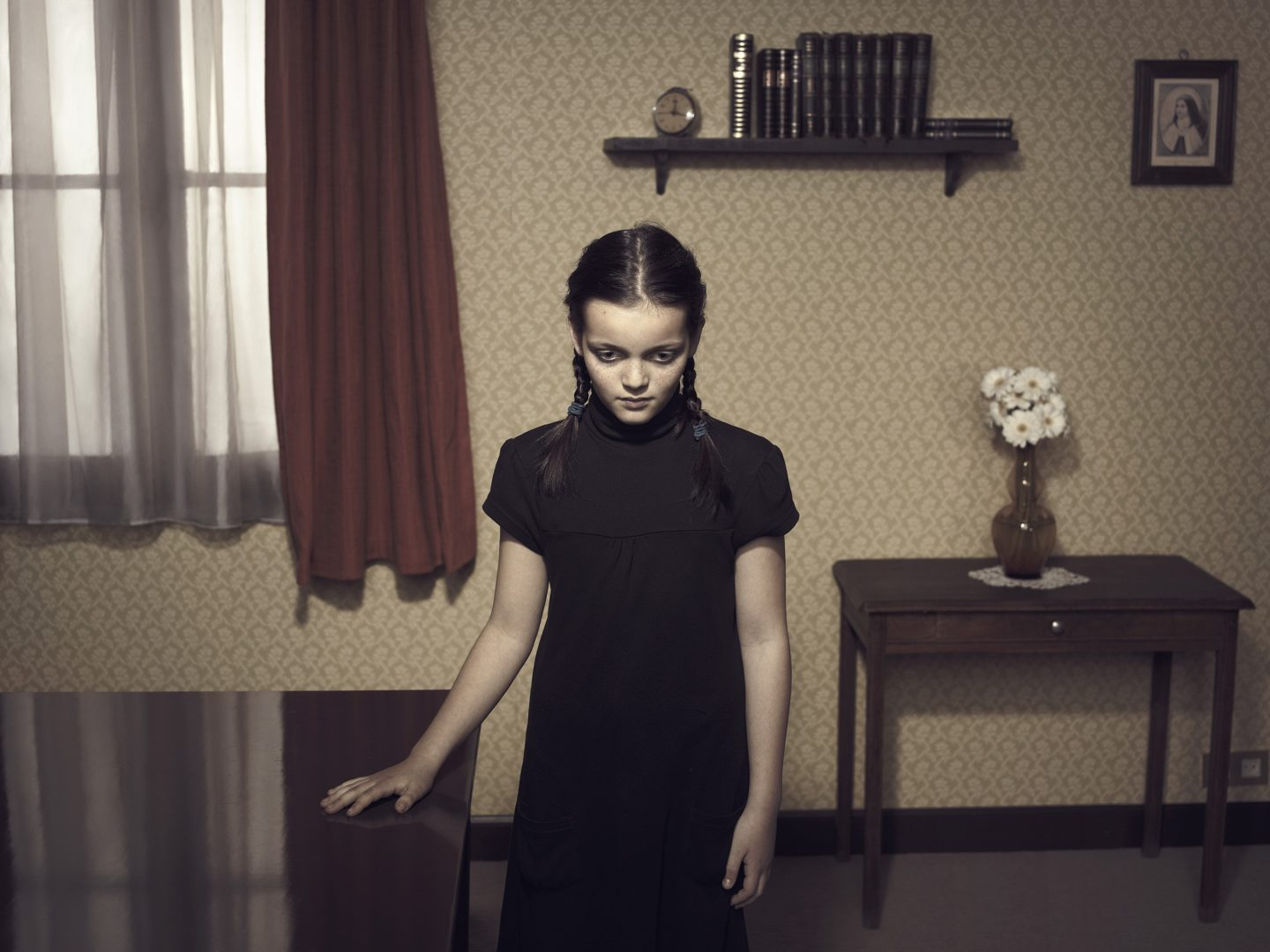 Girl standing at table in middle of room 42 by Stefan Rappo