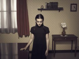 Thumbnail Girl standing at table in middle of room 42 by Stefan Rappo