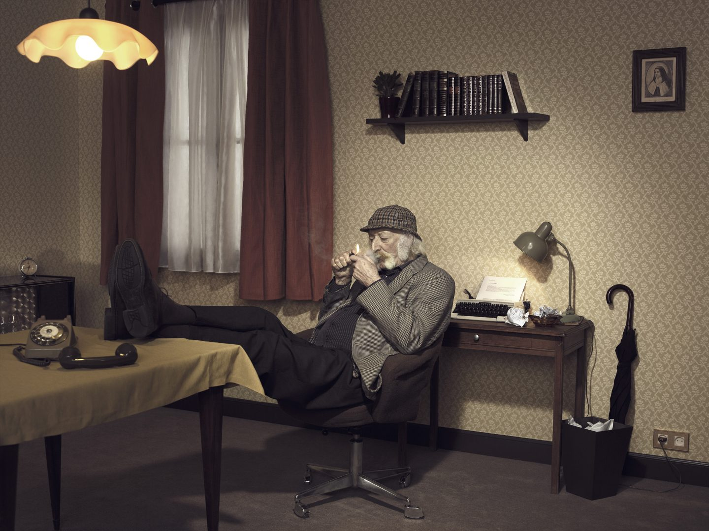 Old man with Sherlock Holmes lock lights pipe in room 42 by Stefan Rappo
