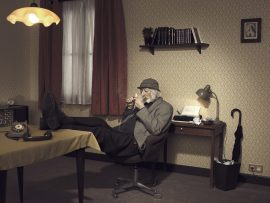 Thumbnail Old man with Sherlock Holmes lock lights pipe in room 42 by Stefan Rappo