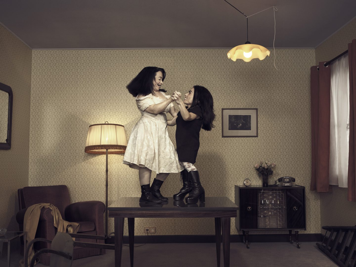 2 dwarfs dancing on table in room 42 by Stefan Rappo