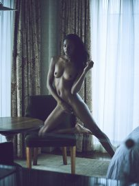 Thumbnail Naked black girl with one knee on table in hotel room by Stefan Rappo