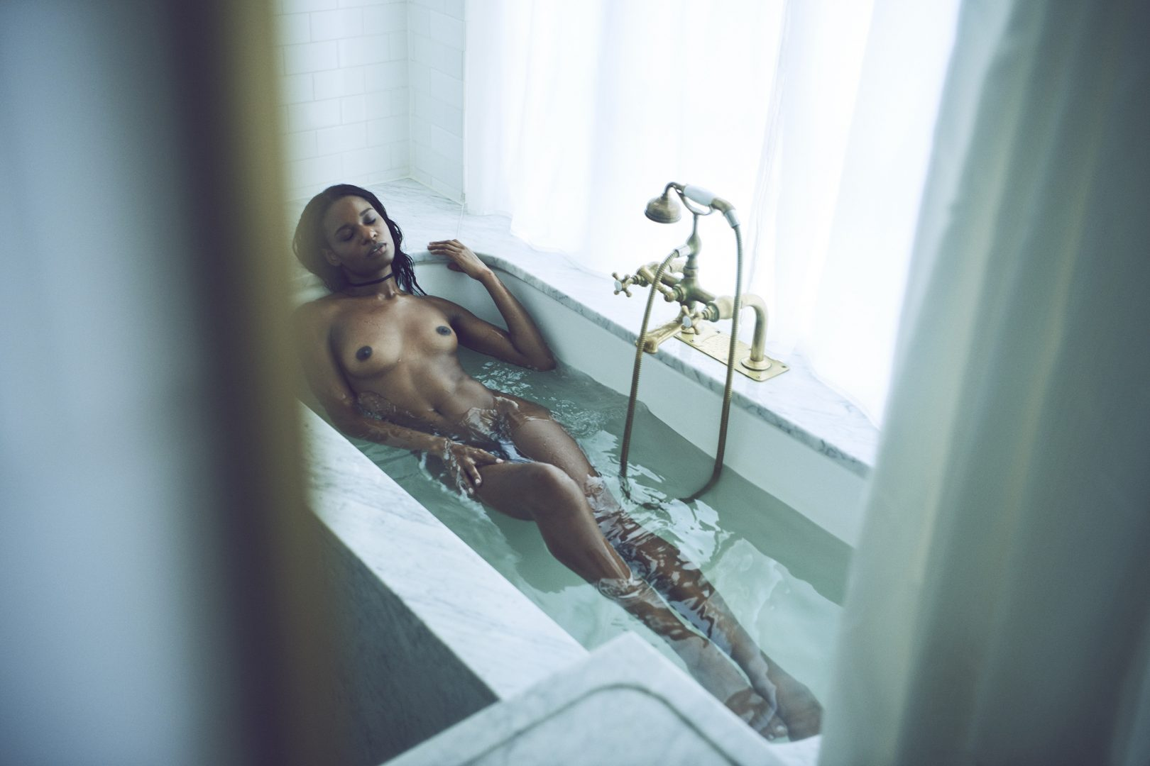 Naked black girl taking bath in hotel room by Stefan Rappo