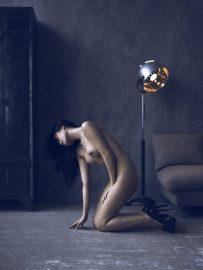 Thumbnail Naked girl on floor by Stefan Rappo