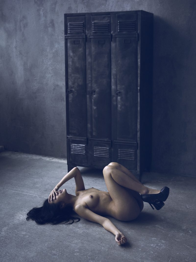 Naked girl on floor by Stefan Rappo