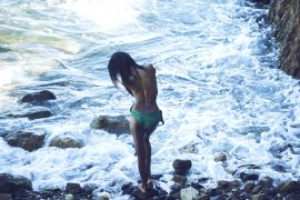 Thumbnail Girl in front of sea in swimsuit by Stefan Rappo