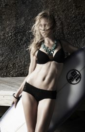 Thumbnail Girl in swimsuit and surfboard by Stefan Rappo