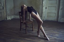 Thumbnail Girl in lingerie leaning on chair by Stefan Rappo