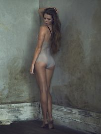 Thumbnail Girl in lingerie from the back in old hotel room by Stefan Rappo