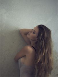 Thumbnail Girl in lingerie leaning against a wall in ld hotel room by Stefan Rappo