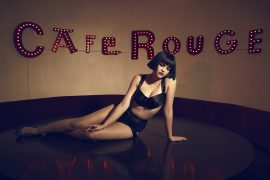 Thumbnail Girl in lingerie sitting on table in caffe rouge by Stefan Rappo