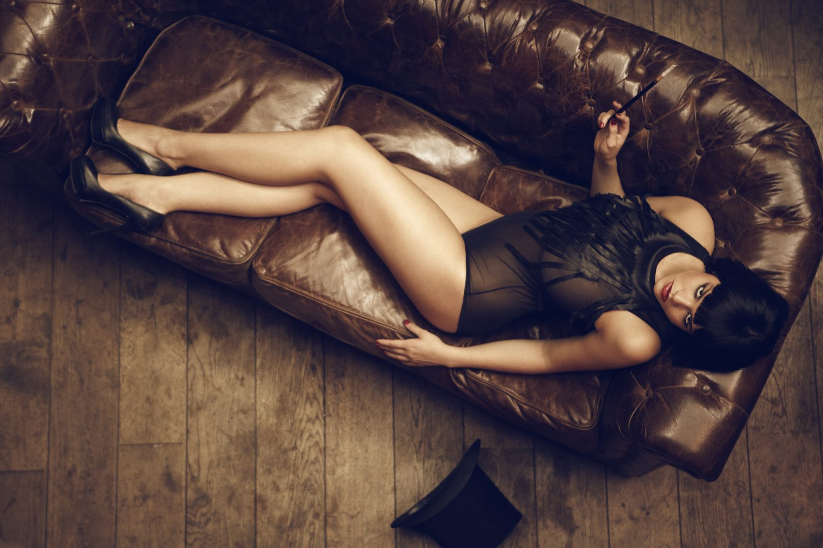 Girl in lingerie lying on sofa by Stefan Rappo